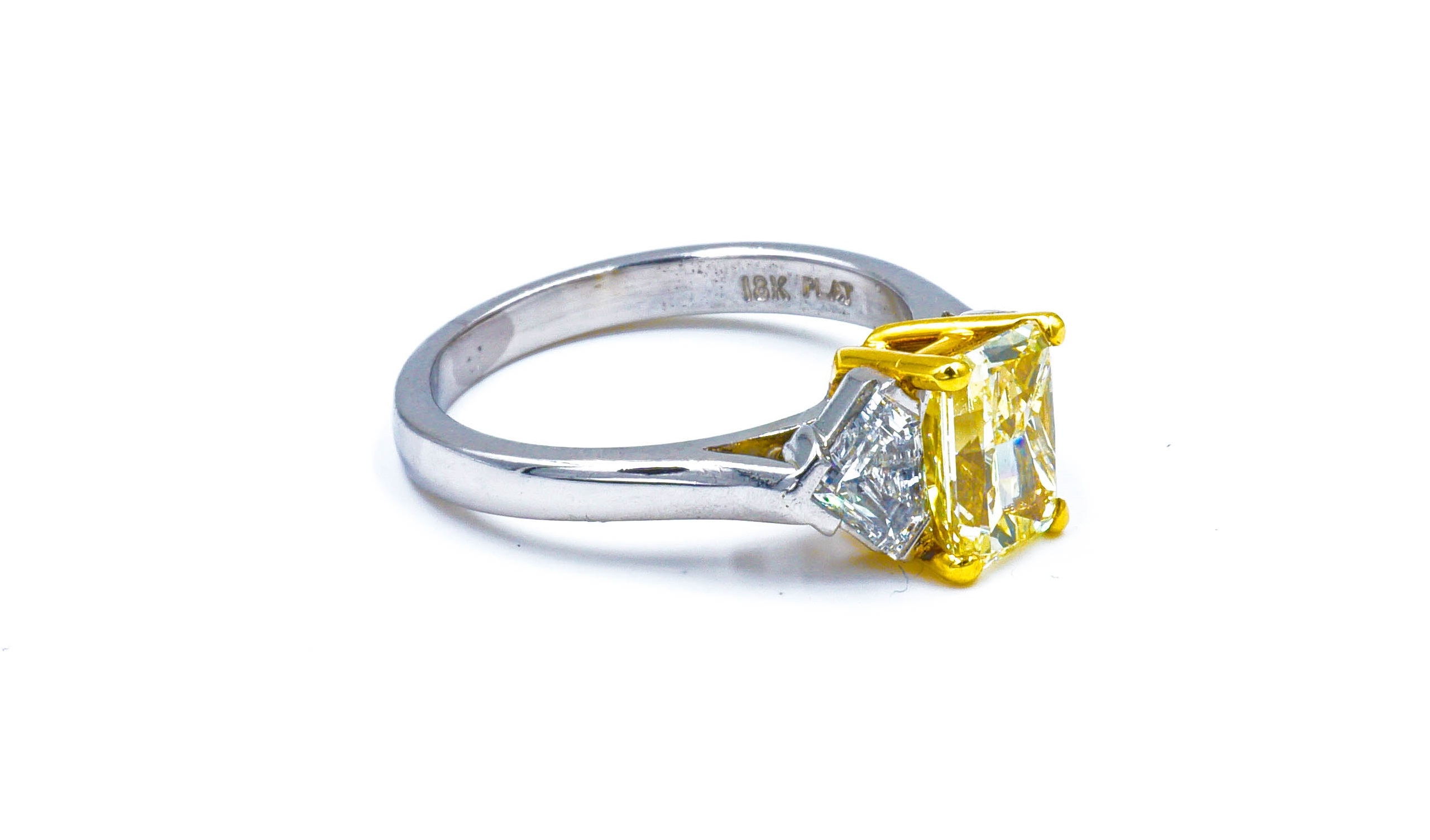 Fancy Yellow Radiant Cut Diamond Three Stone Engagement Ring