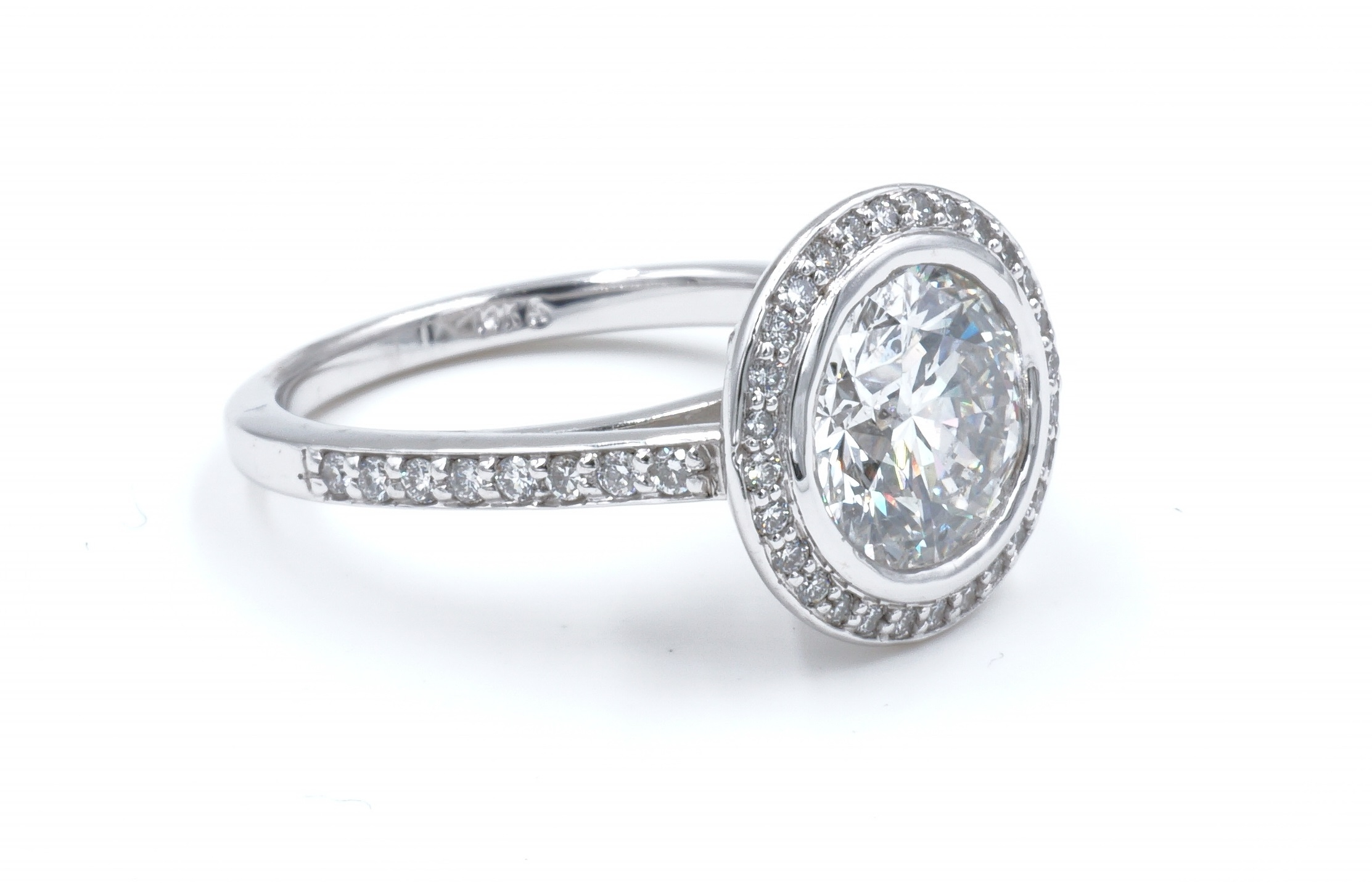 Halo Style Bezel Set Round Brilliant Cut Diamond Engagement Ring