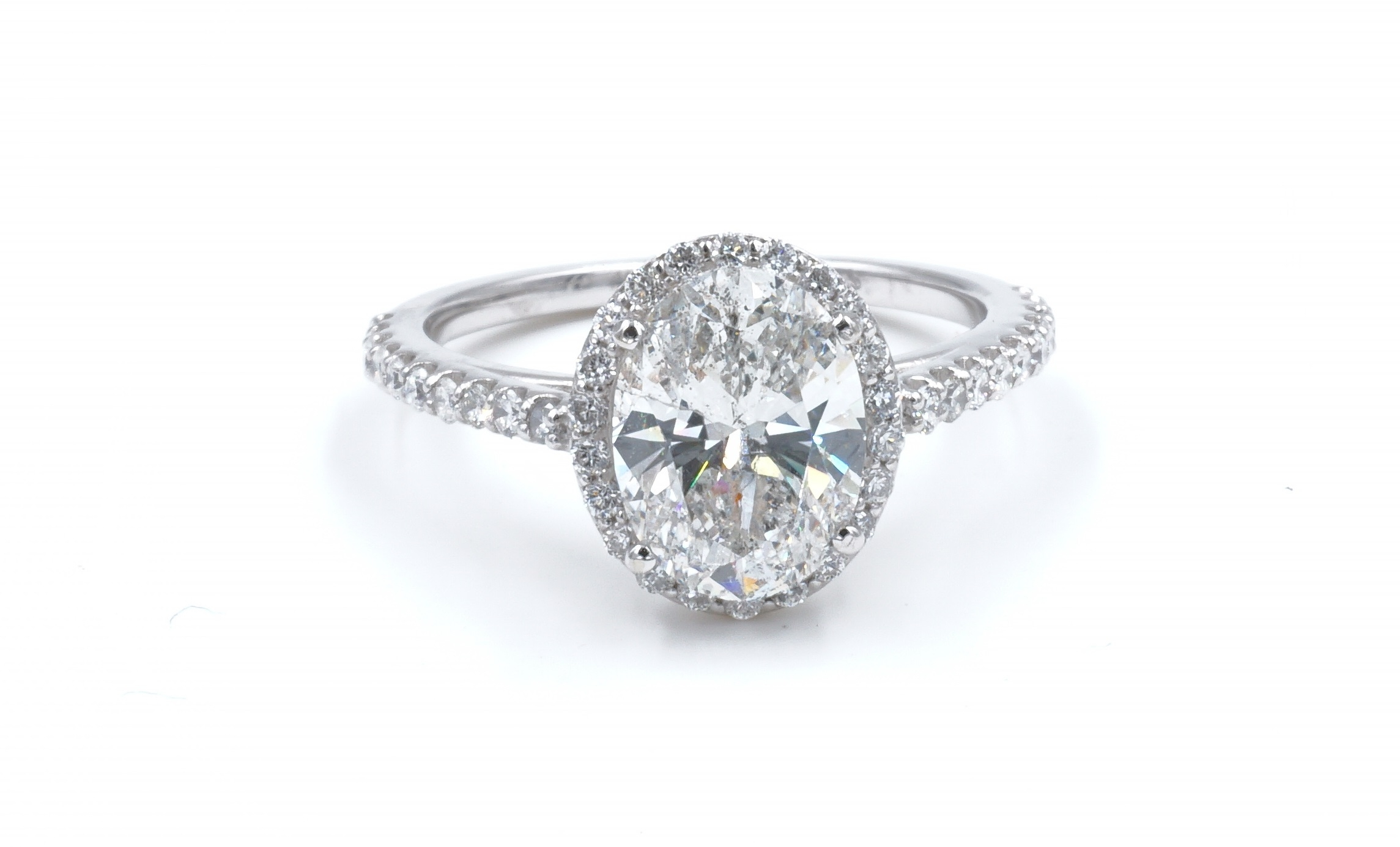 Halo Style Oval Cut Diamond Engagement Ring